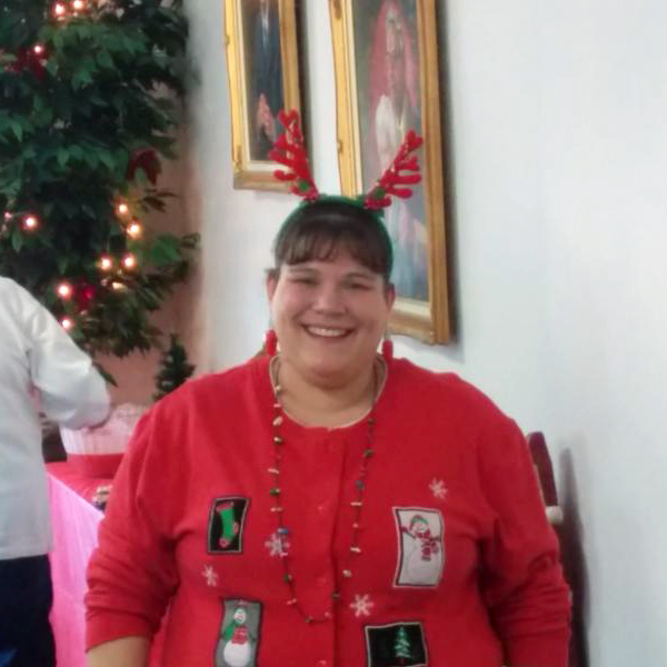 a helper wearing a Christmas sweater and antlers